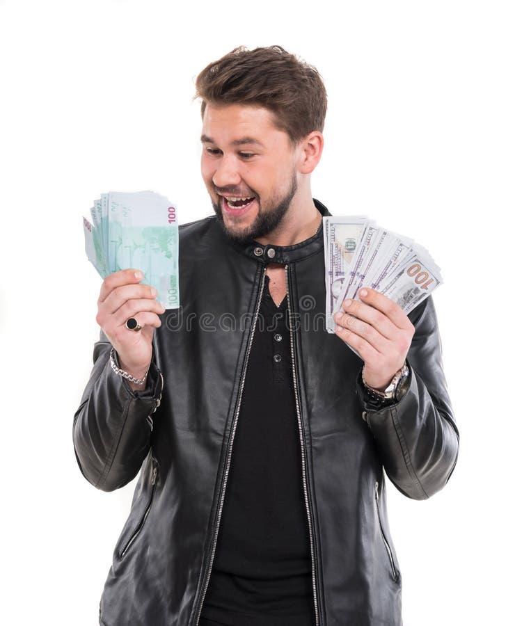Homme d'affaires de sourire avec l'argent américain du dollar et d'euro images stock