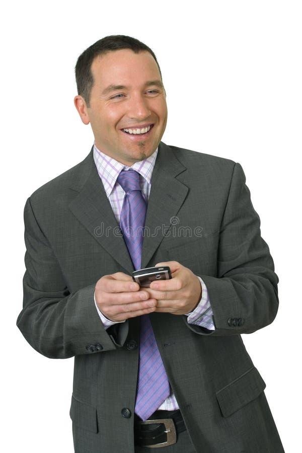 Homme d'affaires de sourire avec PDA photographie stock