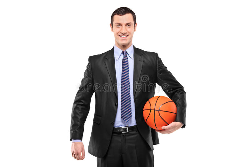 Homme d'affaires de sourire retenant un basket-ball images stock