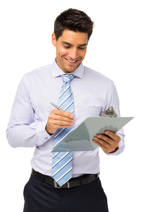 Homme d'affaires de sourire Writing On Clipboard photos stock