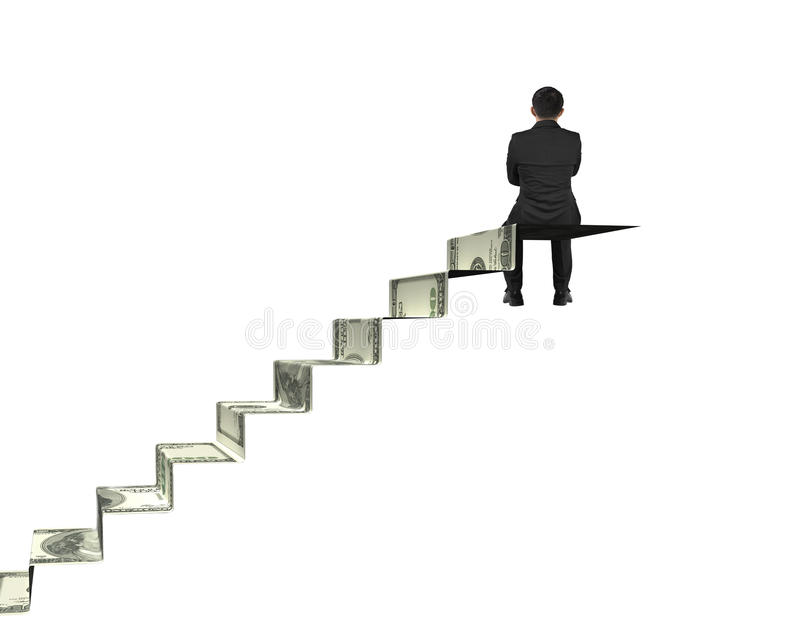 Homme d'affaires de vue arrière s'asseyant sur des escaliers d'argent images stock