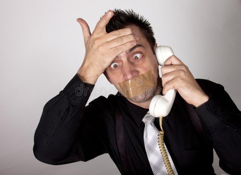 Homme d'affaires drôle avec la bande sur sa bouche photographie stock libre de droits