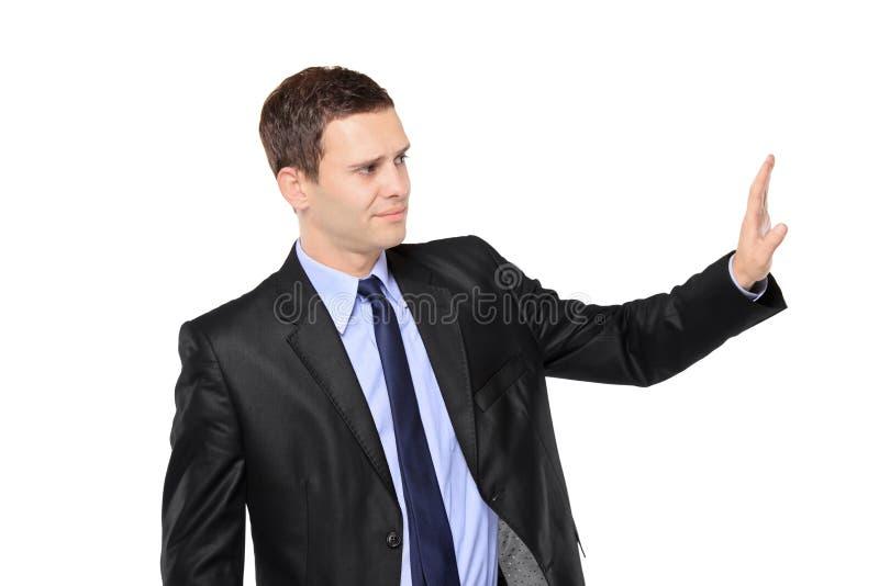 Homme d'affaires effectuant le signe d'arrêt photographie stock
