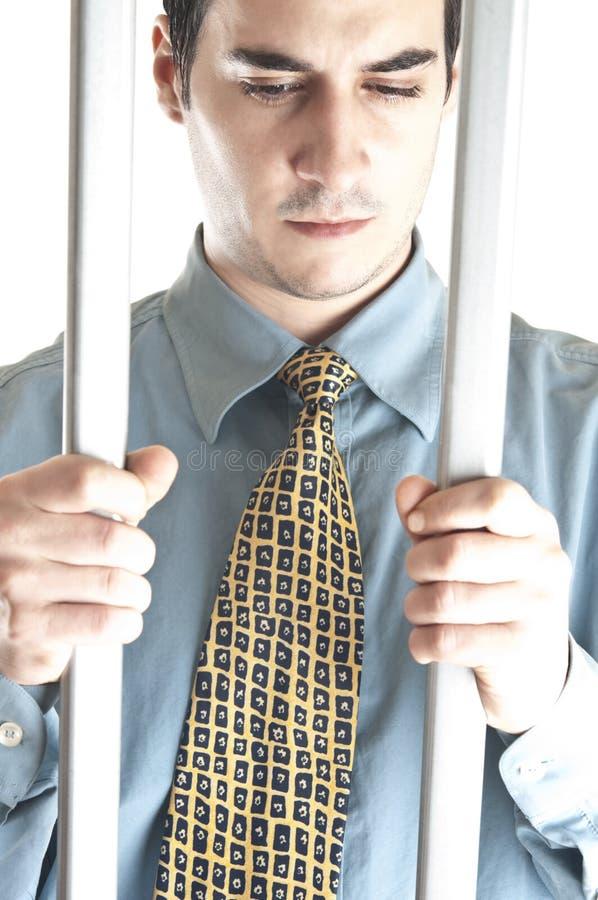 Homme d'affaires en prison photos stock