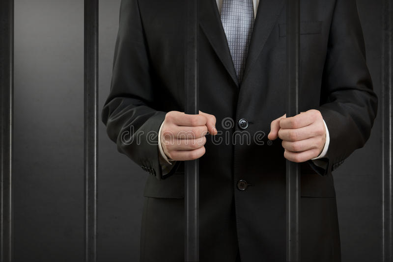 Homme d'affaires en prison photo libre de droits