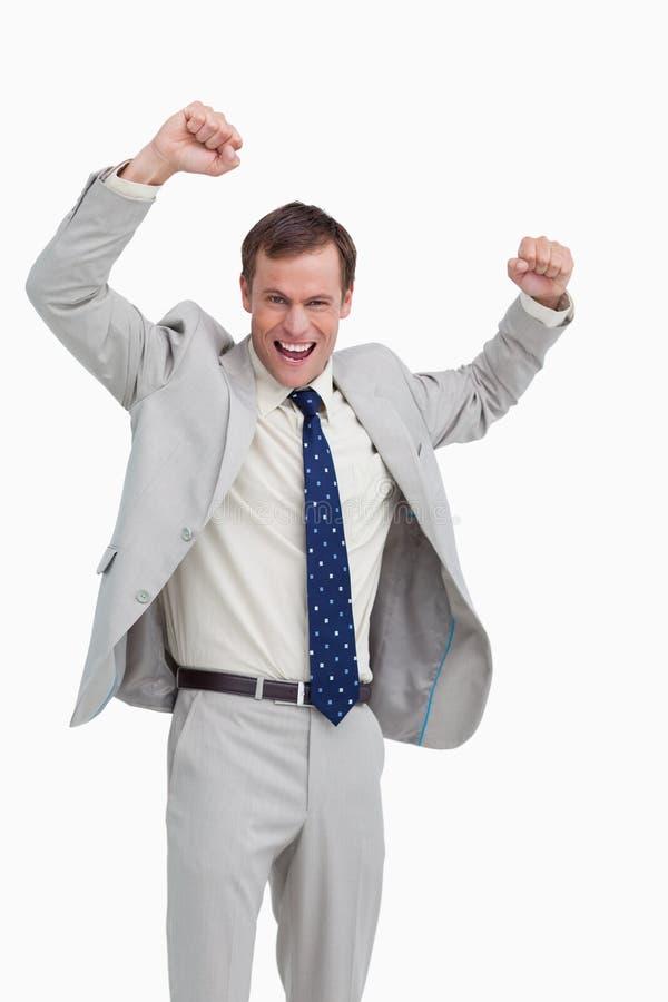 Homme d'affaires encourageant avec ses bras vers le haut photographie stock libre de droits