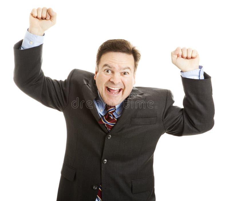 Homme d'affaires encourageant pour la joie photos stock