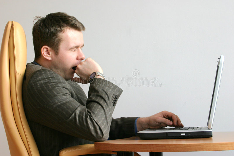 Homme d'affaires ennuyé et de baîllement photos stock