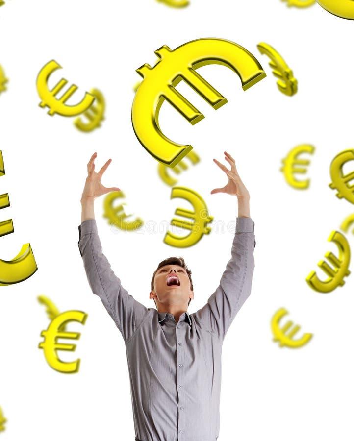 Homme d'affaires essayant d'attraper la chute vers le bas euro. image libre de droits