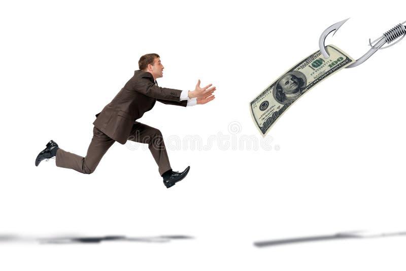 Homme d'affaires essayant d'attraper le dollar image libre de droits