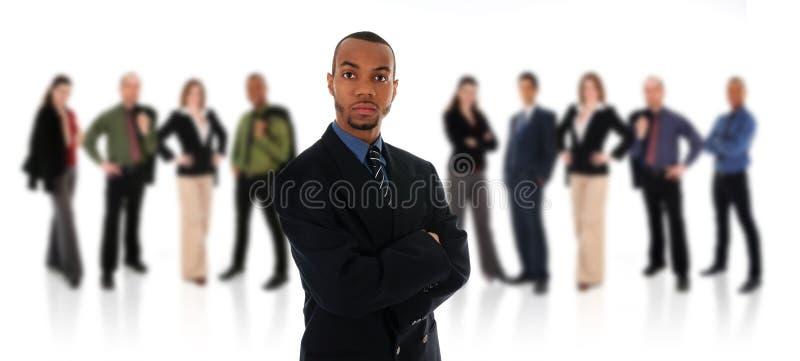 Homme d'affaires et équipe africains photo stock
