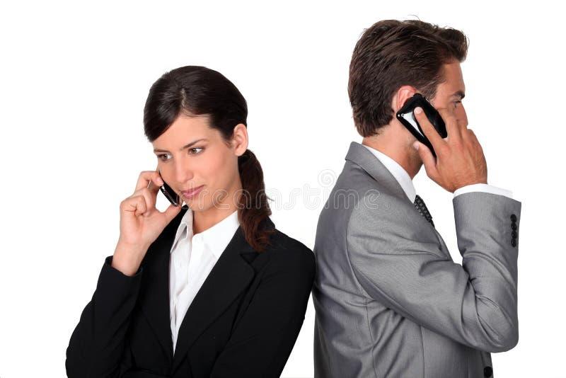 Homme d'affaires et femme d'affaires photos stock