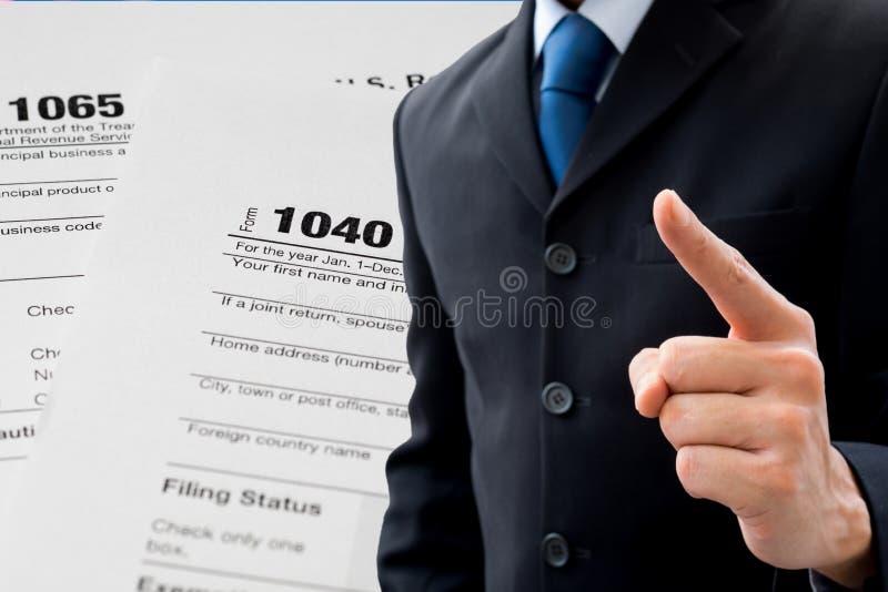 Homme d'affaires et impôt photographie stock libre de droits