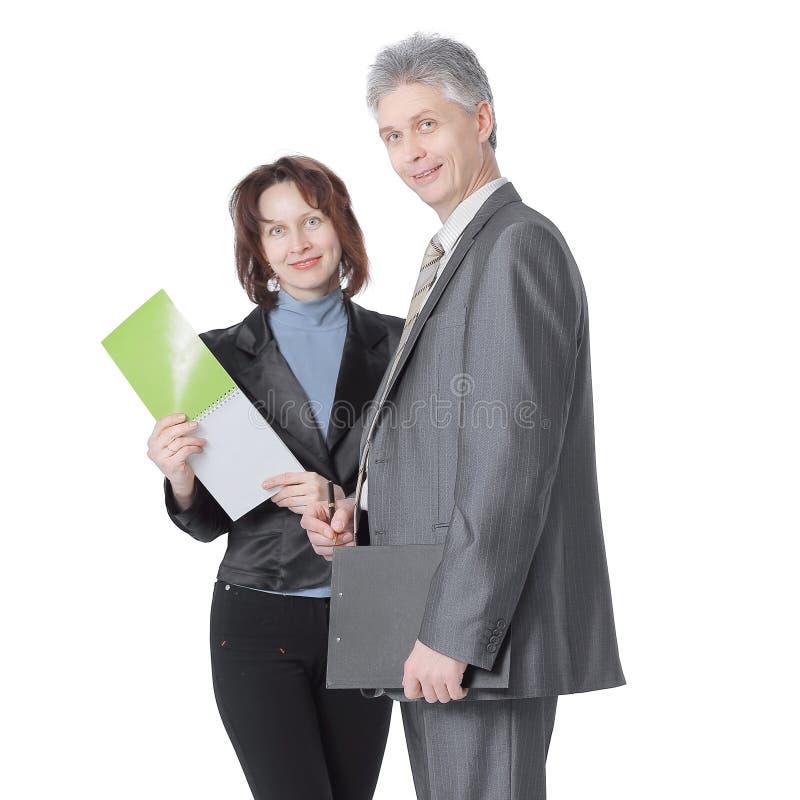 Homme d'affaires et questions de discussion auxiliaires femelles de travail photos libres de droits