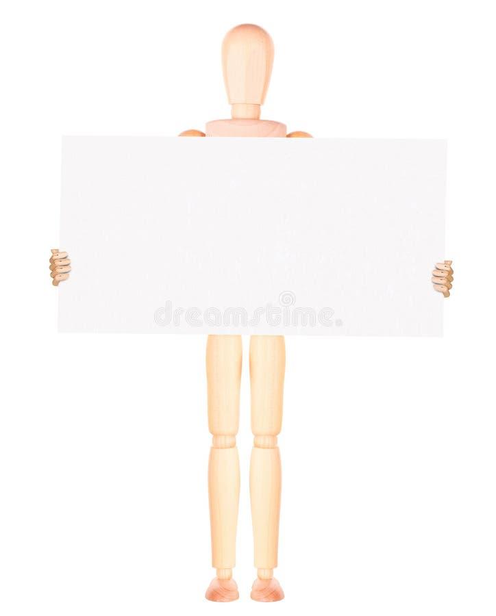 Homme d'affaires factice en bois avec la bannière vide image libre de droits