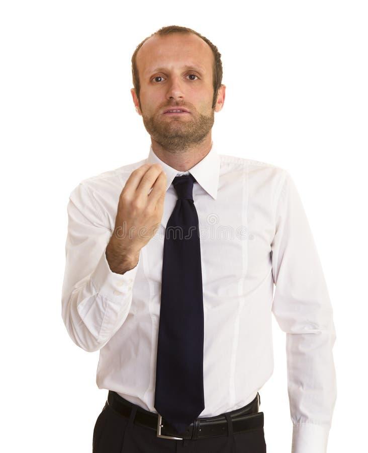 Homme d'affaires faisant un geste italien images stock