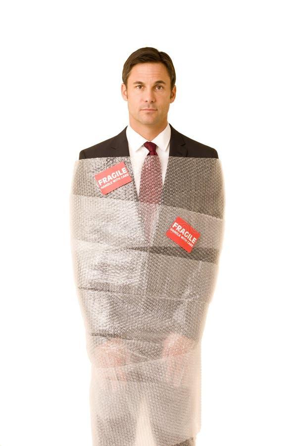 Homme d'affaires fragile image stock