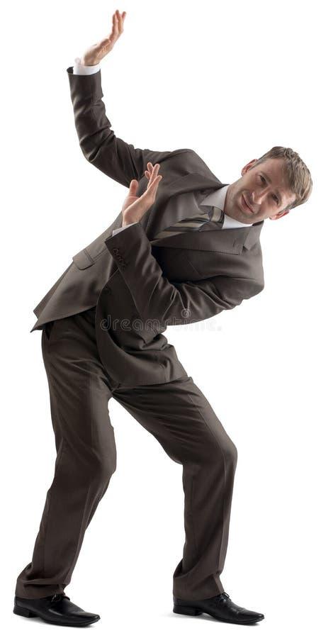 Homme d'affaires gêné défendant avec le corps photographie stock libre de droits