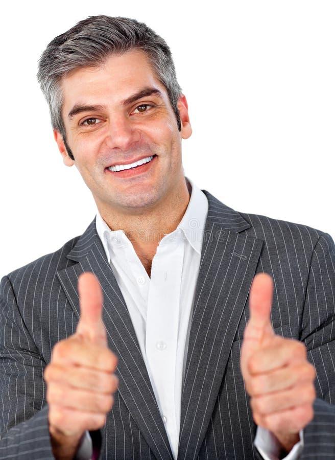 Homme d'affaires heureux avec des pouces vers le haut photo stock