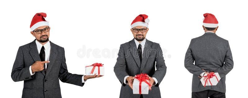 Homme d'affaires heureux avec le cadeau photo stock