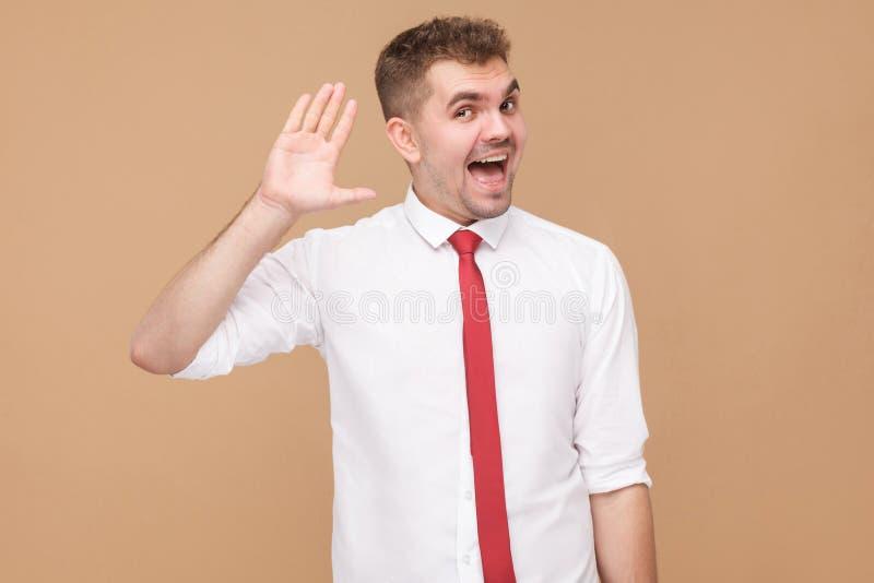 Homme d'affaires heureux montrant salut, bonjour signe image stock