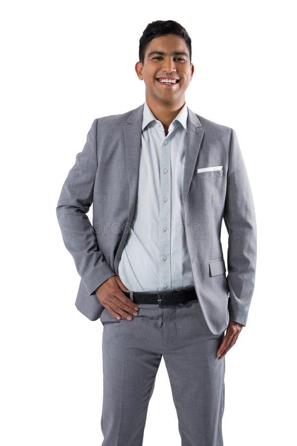 Homme d'affaires heureux se tenant sur le fond blanc images libres de droits