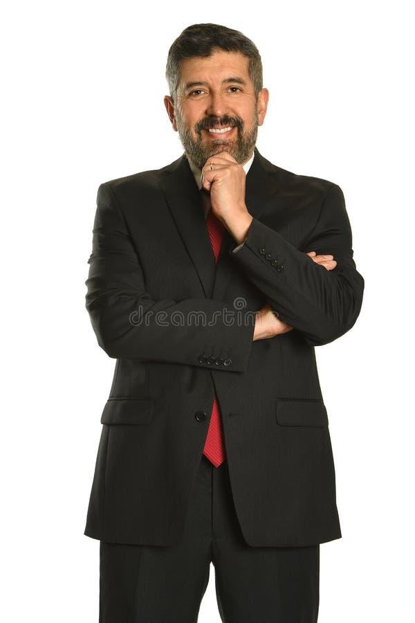 Homme d'affaires hispanique avec la main sur Chin photo libre de droits