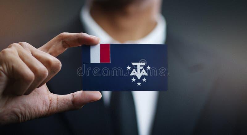 Homme d'affaires Holding Card de drapeau du sud français photo libre de droits