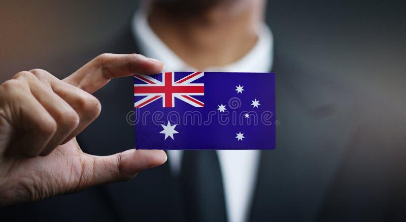 Homme d'affaires Holding Card de drapeau de l'Australie photo stock