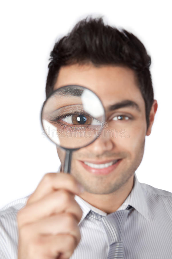 Homme d'affaires Holding Magnifying Glass image stock