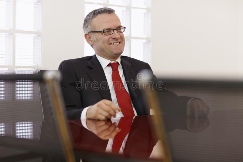 Homme d'affaires lors de la réunion de la société photo libre de droits
