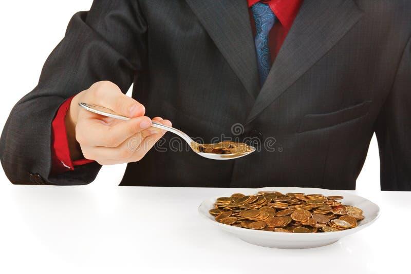 Homme d'affaires mangeant l'argent photographie stock libre de droits