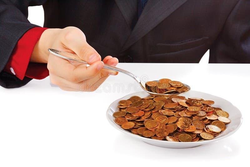 Homme d'affaires mangeant l'argent image libre de droits