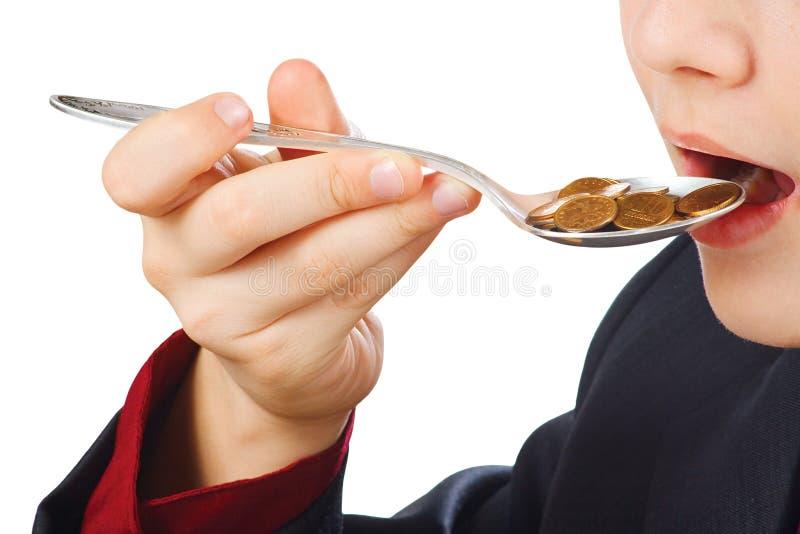 Homme d'affaires mangeant l'argent photo libre de droits