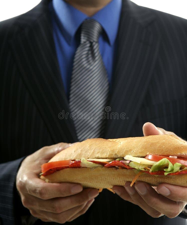 Homme D Affaires Mangeant La Camelote D Aliments De Préparation Rapide Image libre de droits
