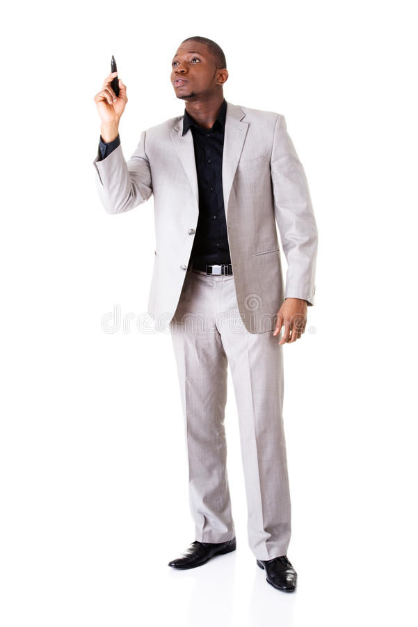 Homme d'affaires masculin se dirigeant haut avec le stylo. photo stock