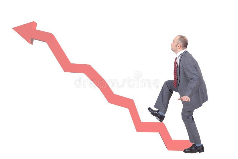 Homme d'affaires montant une flèche de graphique photo stock