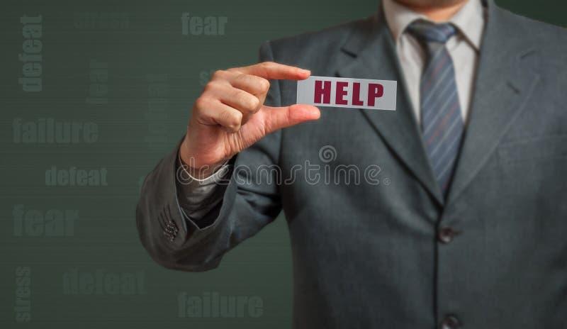 Homme d'affaires montrant la carte avec le texte - aide image libre de droits