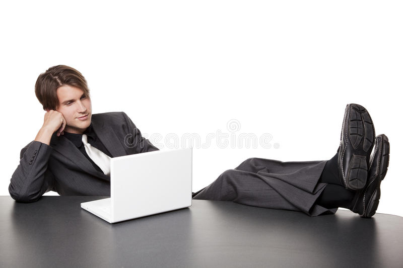 Homme d'affaires - ordinateur portatif relaxed photo stock