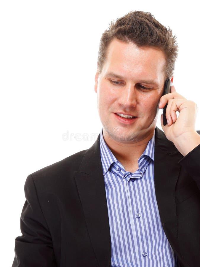 Homme d'affaires parlant de son mobile d'isolement image libre de droits