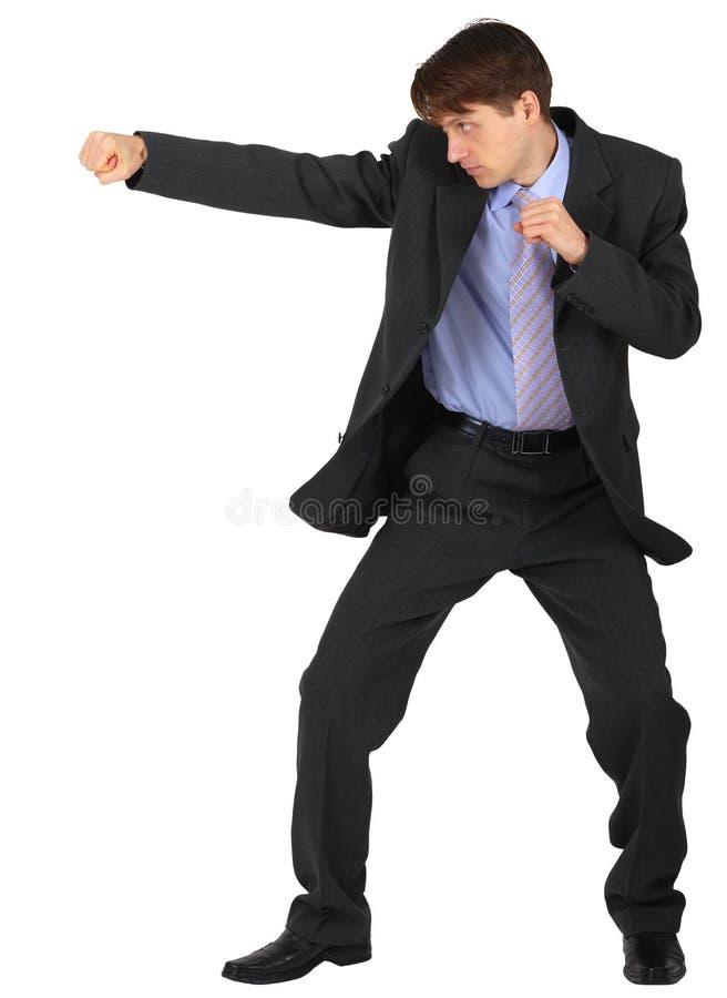 Homme d'affaires poinçonnant sur le fond blanc image libre de droits