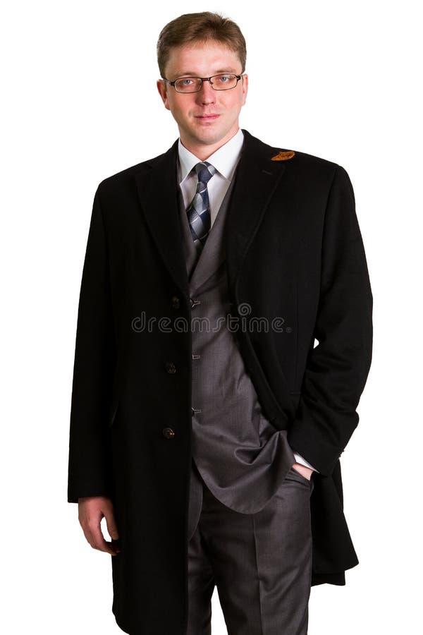Homme d'affaires posant dans un costume image stock
