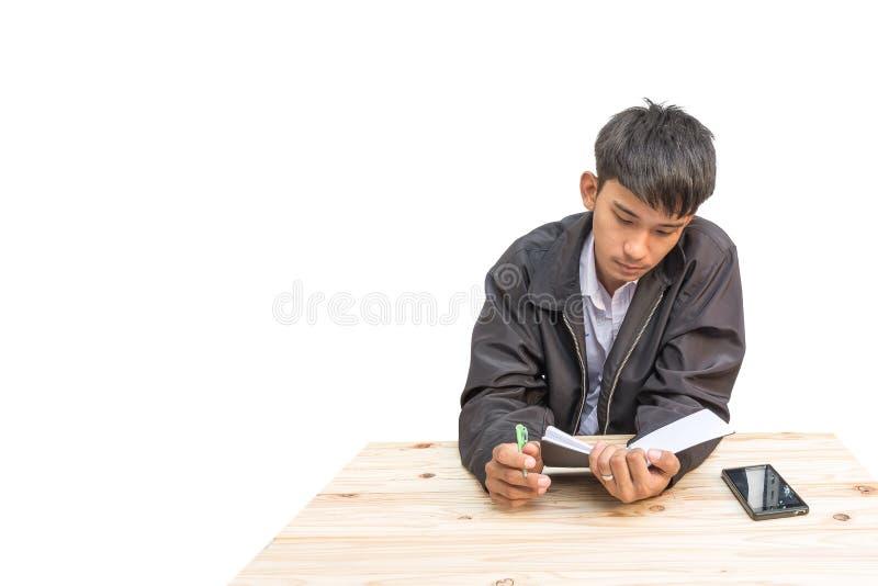 Homme d'affaires prenant une note financière sur le fond blanc photos libres de droits