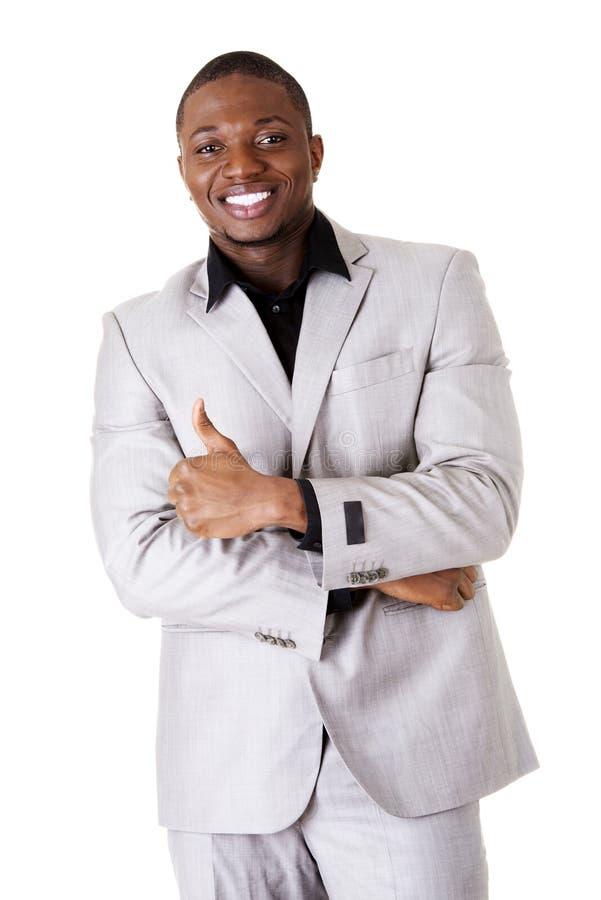 Homme d'affaires réussi heureux faisant des gestes CORRECT. photo stock