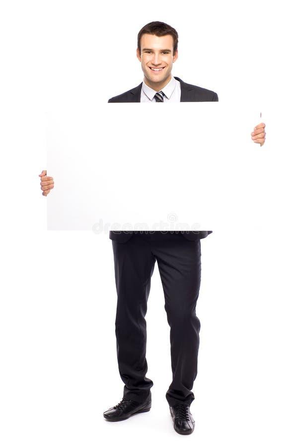 Homme d'affaires retenant l'affiche blanc photographie stock