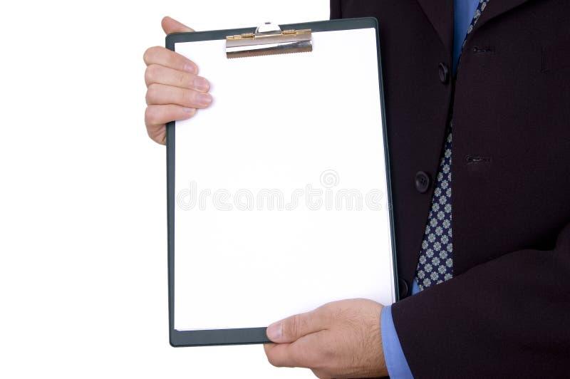 Homme d'affaires retenant la planchette blanc photographie stock
