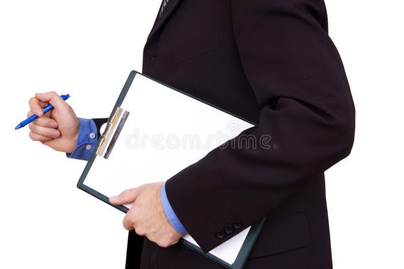 Homme d'affaires retenant la planchette blanc photographie stock libre de droits