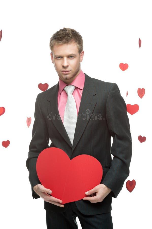Homme d'affaires retenant le grand coeur rouge photos libres de droits
