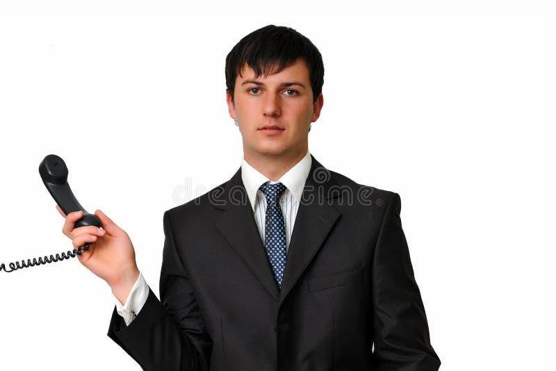 Homme d'affaires retenant un récepteur de téléphone image stock