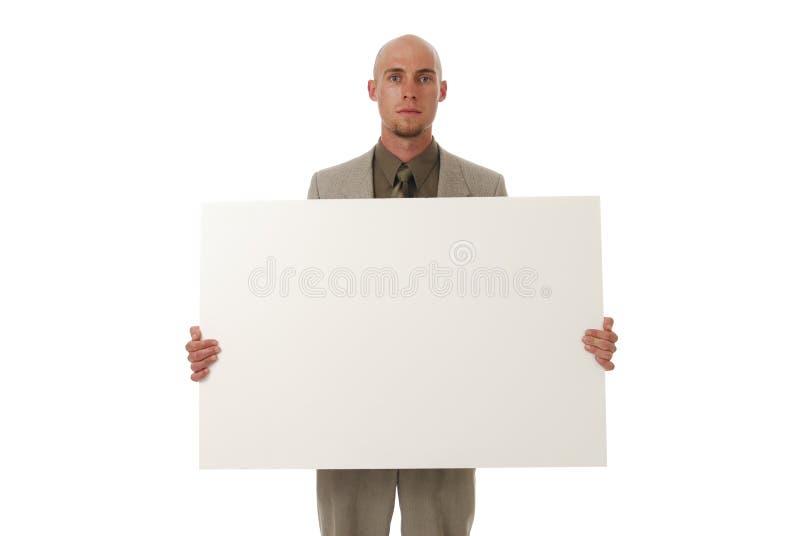 Homme d'affaires retenant un signe images libres de droits